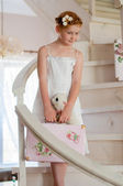 Little girl with a suitcase on the stairs — Stock Photo