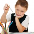 The boy draws pencils in an album on a white background — Stock Photo #31398039