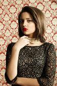 Young beautiful girl in jewelry — Zdjęcie stockowe