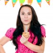 Young girl with cake in hand on a white background — Stock Photo