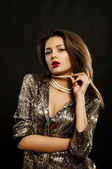 Young beautiful young girl in beautiful jewelry — Stock Photo