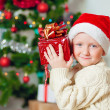 Little boy with gifts near a Christmas tree — Stock Photo