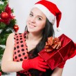 Beautiful girl  near a christmas tree with gifts — 图库照片
