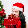 Beautiful girl  near a christmas tree with gifts — Foto Stock