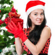 Beautiful girl  near a christmas tree with gifts — Stock Photo