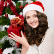 Beautiful girl  near a christmas tree — Stock Photo