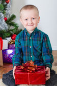 Little boy near Christmas tree — Stock Photo