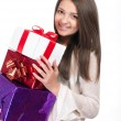 Beautiful young girl with gift in hand — Stock Photo #37416275