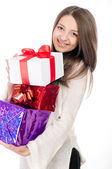 Beautiful young girl with gift in hand — Stock Photo