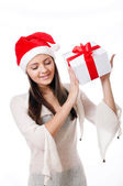 Beautiful young girl with gift in hand — Stockfoto