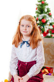 Little girl near Christmas tree with gifts — Stock Photo