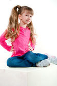Little girl with long curly hair in a pink blouse — Stock Photo