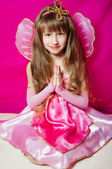 Little girl in a pink dress and wings — Stock Photo