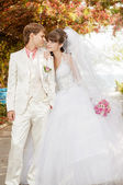 Beautiful bride and groom smilling — Stock Photo