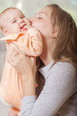 Young mother holding a baby — Stock Photo