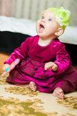 Little girl in a beautiful dress at home — Foto de Stock