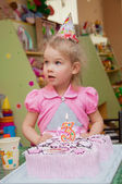 Little girl with birthday cake on birthday party — Foto de Stock