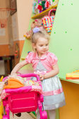 Little girl with toys in the playroom — Stok fotoğraf