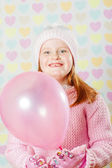 Little girl in a pink hat and a sweater — Stock Photo