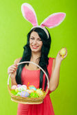 Beautiful girl with a basket of Easter eggs — Стоковое фото