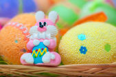 Easter  bunny with colored eggs — Stock Photo