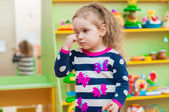 Little girl playing with toys in  playroom — Foto de Stock
