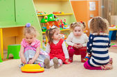 Little girls playing with toys in  playroom — Stock Photo