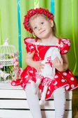 Beautiful girl in a red dress and  wreath of red berries — Stock Photo