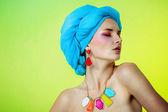 Young beautiful girl in a turban in beautiful earrings — Stock Photo