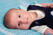 Sweet baby on the bed — Stock Photo
