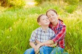 Mom and boy with dandelions in summer — Stock Photo