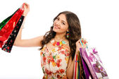 Young beautiful girl with shopping bags on white background — Stock Photo