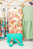 Summer dresses hanging on hangers and shoes — Stok fotoğraf