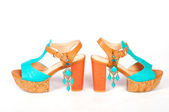 Summer beautiful high heels  and beautiful earrings — Stock Photo