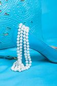 Beautiful blue shoes and handbag, pearls — Stock Photo