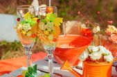 Orange picnic with oranges flowers and glasses — Stock Photo