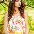Young beautiful girl in a wreath of flowers with lemonade — Stock Photo #48459867