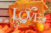 Decorations word love on an orange background in the summer — Stock Photo