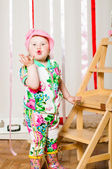 Baby girl in a fashionable suit, cap — Stock Photo