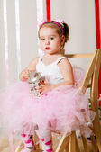 Baby girl in lush color skirt — Stock Photo