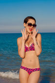 Young beautiful girl in swimsuit at the beach — Stok fotoğraf