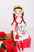 Textile souvenir doll in  costume — Stock Photo