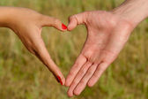 Hands folded pair of heart-shaped — Stock Photo