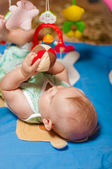 Little baby playing with toys — Stock Photo