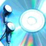 Ear-phones on cd — Stock Photo