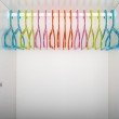 Children's wardrobe with colored hangers — Stock Photo #25005375
