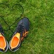 Sneakers on grass with heart — Stock Photo