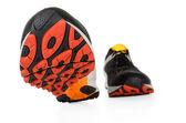 Wandelen zwarte sneakers geïsoleerd op wit — Stockfoto