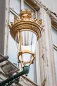 Antic royal street lantern on a wall in Brussel, Belgium — Stock Photo