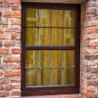 Window of a medieval building with old brick wall — Stock Photo #43462595